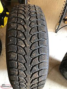 Four Winter Studded Tires (265 70 R17)
